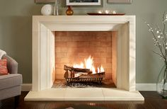 """""""Giada"""" fireplace surround by Eldorado Fireplace Surrounds. Shown in Oyster Shell with a honed finish."""