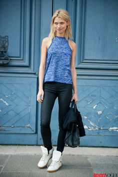 A #simple blue tank pops with black waxed jeans and a carry-everywhere bag. C'est chic!