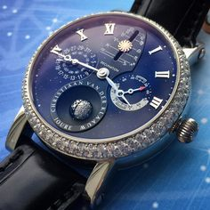 A custom made CVDK Real Moon 1980 in steel with a mesmerising Aventurine glass dial, a diamond bezel and a custom made diamond 3d moon phase. . It has the most complications of all our CVDK watches. It contains a 3D moon phase, the declination of the sun and an eclipse hand, indicating a solar or a lunar eclipse somewhere in the world. . Awarded 'European Watch of the Year 2012' by an international jury in London.