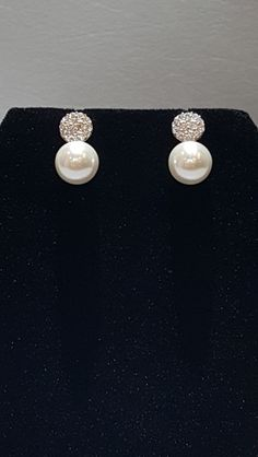 "Silver Sparkle & Pearl Drop Earrings The Perfect Accessory: https://www.shoppinwithsailin.com/collections/earrings/products/silver-sparkle-pearl-drop-earrings?utm_content=bufferfed61&utm_medium=social&utm_source=pinterest.com&utm_campaign=buffer   Silver sparkle (cubic zirconia) earrings with pearl drops.  Simple and elegant! Perfect for parties!  1/2"" tall Pierced earrings FREE SHIPPING!!!"