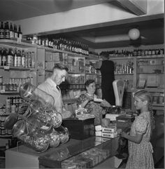 1950's. Store owner Ruinerwold in his store at the Achillesstraat in Amsterdam. #amsterdam #1950 #Achillesstraat