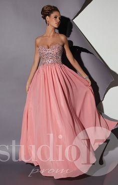 Oh hello princess!! Studio 17 12452 is a totally elegant and sweet design! It features a sweetheart neckline with stunning rhinestone and sequin embellishments that scatter down to the chiffon skirt. This dress is an ideal design for a girl to dance the night away at any occasion!!