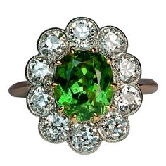 Russian Demantoid Diamond Cluster Ring   From a unique collection of vintage cluster rings at http://www.1stdibs.com/jewelry/rings/cluster-rings/