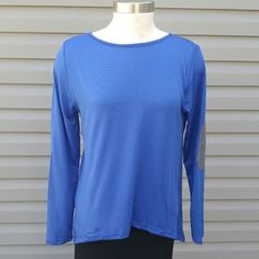 """Bling top with """"glitter"""" elbow patches. Royal Blue bling top with """"glitter"""" elbow patches in M   PRICE FIRM unless Bundled. These are NWOT Retail. Measurements available upon request Tops"""