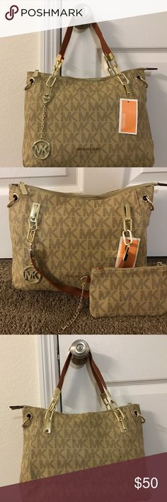 Michael Kors Tan Shoulder Bag and Mini Pouch Tan MK shoulder bag, made of canvas. Comes with mini pouch perfect to use inside the bag or as a clutch for a night out. Also comes with a long crossbody strap. Not Real Michael Kors! Bags Shoulder Bags