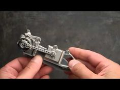 Stefan Steigerwald Steampunk Biohazard Folding Knife. Beautifully engraved with a mechanical backlock and an iris hinge. Crazy cool.