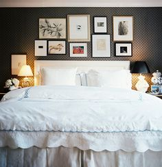 Bedroom Photo - A grouping of art above an upholstered headboard paired with white scalloped bedding