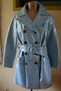 1960s Baby Blue crinkle vinyl, has big lapels and big antique gold colored buttons.