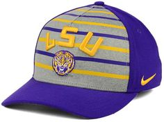 Support your team in classic style with the Nike NCAA Classic Verbiage Swoosh cap. The hat features the LSU Tigers logo, making it perfect for football, basketball, baseball and any other collegiate sport. Mid crown Structured fit Normal bill Raised embroidered team logo at front Flat embroidery team wordmark at back Stitched brand logo at left Stretch fitted Polyester/spandex Spot clean