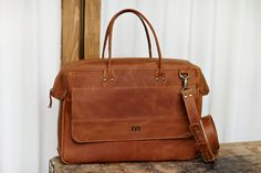 Handmade satchel bag that would be perfect for short trips. Made from genuine leather that will last for a very long time. This bag has two top handles and adjustable long ...