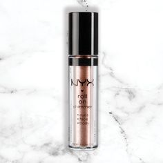Nyx Rose Gold roll on shimmer - 15 Products That Will Make You Look Like A Rose Gold Goddess