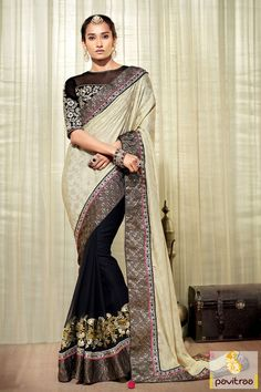 The beautiful black and cream georgette jacquard party wear saree appears nice with heavy embroidery work,butti work,black stone work and lace patti work.
