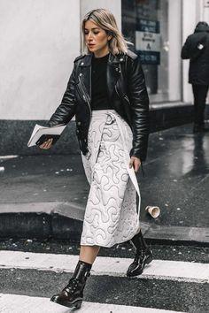 Leather jacket, black tee, white skirt, black booties