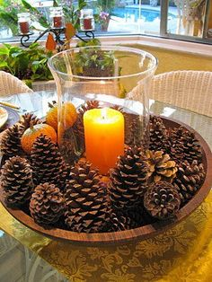DIY Fall Centerpiece with Pine Cones. Simply arrange pine cones in natural colors around the big glass candle holder with a lighting candle inside. An elegant fall centerpiece to beautify your dinner table. Thanksgiving Crafts, Fall Crafts, Holiday Crafts, Thanksgiving Tablescapes, Thanksgiving Salad, Diy Crafts, Thanksgiving Table Centerpieces, Rustic Thanksgiving, Rustic Crafts