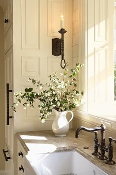 Great corner with raised paneling, candlestick sconce & wildflowers to balance it out.  Also like the oversized cabinet handle in view.