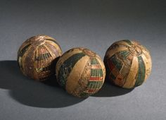 Toy balls made of linen, hollow, exterior elaborated with red and green segmented decoration form by strips of reed, with circular fragments. Culture/period Roman Period. Findspot: Egypt (Africa,Egypt)