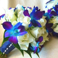 Love the blue orchid and white rose combination