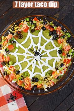 Delicious 7 Layer Taco Dip Recipe all decked out for Halloween. Delicious 7 Layer Taco Dip Recipe all decked out for Halloween. The post Delicious 7 Layer Taco Dip Recipe all decked out for Halloween. appeared first on Halloween Party. Halloween Dip, Halloween Desserts, Hallowen Food, Halloween Appetizers, Halloween Dinner, Halloween Food For Party, Appetizers For Party, Halloween Potluck Ideas, Party Dips