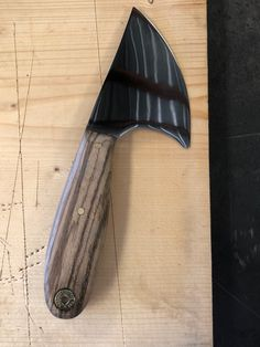 Skinner forged from ground auger tooth
