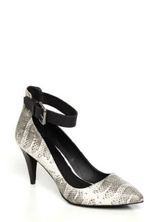 """Joe's Ned is a pointed toe pump with a black mid-height heel and a 3/4"""" thick adjustable black leather ankle strap. Featured in a black/white snake print which lends an exotic appeal to a ladylike silhouette."""