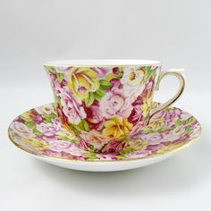 Colclough tea cup and saucer, covered with colorful rose chintz. Gold trimming on cup and saucer edges. Excellent condition (see photos). Markings read: Colclough China Made in Longton England Genuine Bone China Colclough is a company with a long history. Colclough was founded in 1890