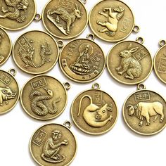 Zodiac charms to carry for protection with the Goddess of Mercy, Kuan Yin, on one side.