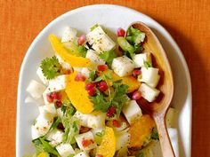 This crunchy and colorful Jiacama-Orange Salad gets a kick from ancho chili powder.