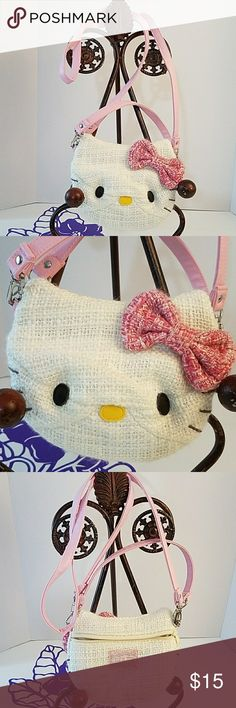 """Hello Kitty crossbody bag purse Grab this for your little one just in time for the holidays. Features Hello Kitty face as the front of the bag with a fully functioning back zipper, and clean inside. Two handles both removable. Short handle drops approximately 5  1/2"""", longer shoulder or cross-body strap drops approximately 22"""". In perfect condition, no flaws. Hello Kitty Accessories Bags"""