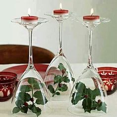 Holly with wine glasses and candles