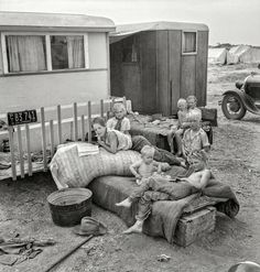 """Okie Tater Tots: 1937-  """"Children from Chickasaw, Oklahoma, in a potato pickers' camp near Shafter, California."""" Medium format nitrate negative by Dorothea Lange"""