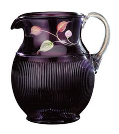 Fenton glass pitcher with enameled flowers.