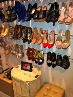 """Curtain Rods for a Shoe Wall AKA """"The Great Wall - AWESOME idea and it works great for all shoes, all sizes and all heel heights."""