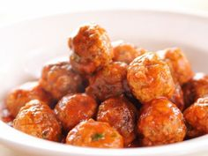 Spicy Italian Meatballs : No longer just for dinner with saucy spaghetti, Ree's two-bite meatballs, simmered in a tomato-garlic sauce, are ready for the appetizer table; she recommends serving them with toothpicks so guests can help themselves.