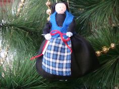 Iceland clothespin doll ORNAMENT Black blue by cherylsdollsnstuff Black And Blue Dress, Black Hair, Blue And White, Metal Spring, White Apron, Clothespin Dolls, Blue Vests, Painted Sticks, Barbie Accessories