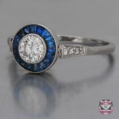Really loving the round diamond/saphire look. Art Deco Engagement Ring.
