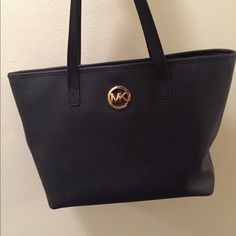 Michael Kors Handbag 100% Michael Kors Handbag Purse, Black with gold accents, one year old Michael Kors Bags