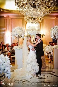 Ceremony – pillars with beautiful #Centerpiece frames the couple.   Florals by Karen Tran Florals #Karentran. Wedding Planner: MONARCH WEDDINGS (www.monarchweddings.com)