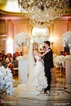 Ceremony – pillars with beautiful #Centerpiece frames the couple.   Florals by Karen Tran Florals #Karentran. Wedding Planner: MONARCH WEDDINGS (www.monarchweddings.com)