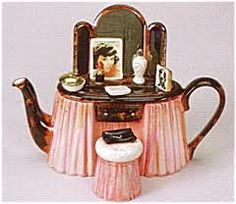 Teapot in the shape of a lady's vanity table.