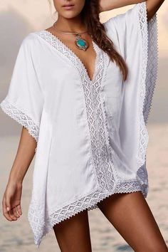 Lace details the hem of this V-neck PilyQ cover-up tunic. Closed sides. Short sleeves. Semi-sheer.   Lily Paradise Tunic by PilyQ. Clothing - Swimwear - Cover Ups Miami, Florida