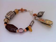 Bracelet pompon tendance orangée