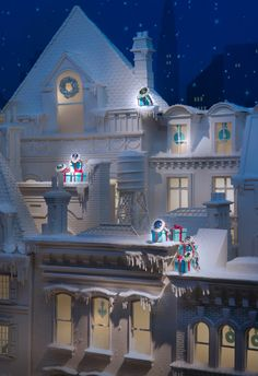 Detail of elegant townhouses highlighted with Tiffany Blue boxes and dazzling gemstone rings.