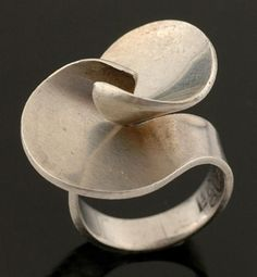 A silver ring by Georg Jensen of abstract twist design in… - Rings - Jewellery - Carter's Price Guide to Antiques and Collectables
