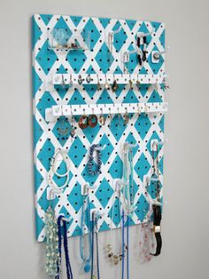 This colorful turqoise jewelry organizer hangs on your wall or closet door. Each long hook holds multiple necklaces, bracelets, rings, and more. It also has special earring holders and even a clear basket for pins and brooches. No more tangled necklaces buried in a box!   Wall Hanging Jewelry Organizer by JansJewelryOrganizer, $47.95
