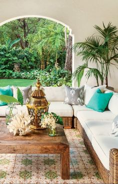 Fabulous Spanish-Style Outdoor Room in Miami #outdoor #bohemian #style #pillows #patterns #colorful #global #backyard #design #decorating