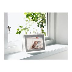 FINLIR Picture holders IKEA Holds 12 pictures so you can create your own picture calendar.  http://www.ikea.com/us/en/catalog/products/90036207/