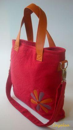 Red big bag with orange handle.