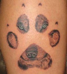 Awesome paw print tattoo