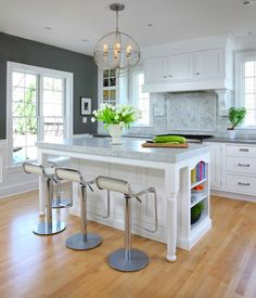 kitchens - Benjamin Moore - Chelsea Gray - LEM Curve Piston Stool charcoal gray paint white kitchen island bianco calcutta marble countertop white inset cabinets Caesarstone Pebble countertop marble subway tiles backsplash Foucault's Orb chandelier