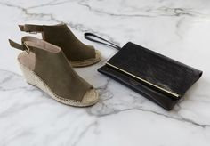 'Nelly' khaki suede wedges and black leather 'Britton' clutch bag by Kurt Geiger London